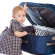 Kid opening a suitcase — Stock Photo #8634584