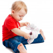 Stock Photo: Baby trying on trainers