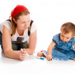 Mom and her baby  writing — Stock Photo