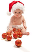Baby in Santa hat playing — Stockfoto