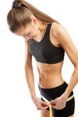 Girl measuring hips — Stock Photo