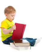 Boy reading books — Stock Photo