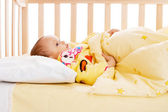 Kid in crib — Stock Photo
