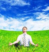 Businessman meditating — Stockfoto