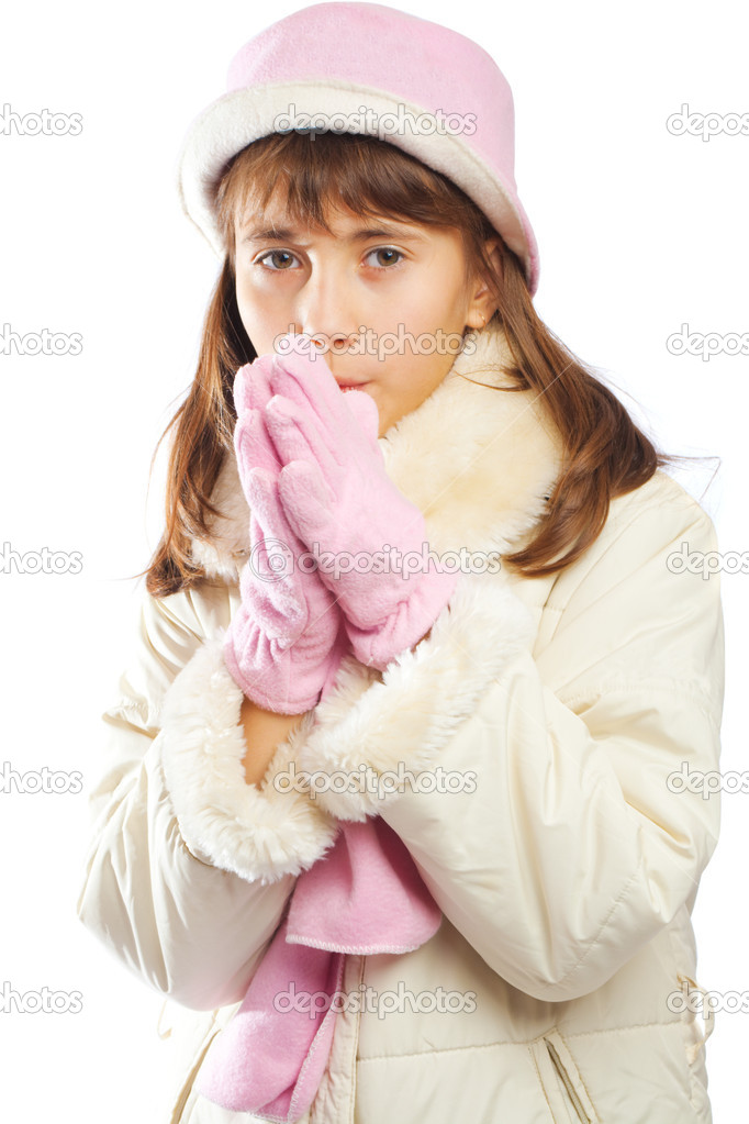 Attractive teenage girl in winter clothes warms up hands — Stock Photo #8630909