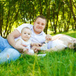 Mother, father and baby in park — Stock Photo