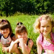 Schoolgirls in grass — Stock Photo