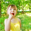 Stock Photo: Girl eating lollipop