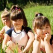 Girls in grass — Stock Photo