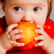 Stock Photo: Baby eating peach