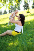 Mother with baby in park — Stock Photo