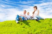 Happy family on grass — Stock Photo