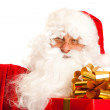 Santa Claus with present — Stock Photo