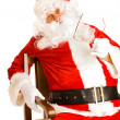 Santa in chair — Stock Photo
