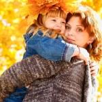 Mother embracing preschool daughter — Stock Photo #8653429