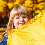 Girl hiding behind umbrella — Stock Photo #8653432
