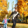 Stock Photo: Dad and daughte in autumn park