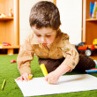 Stock Photo: Boy drawing picture