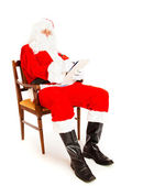 Santa Claus with wish list — Stock Photo