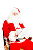 Santa Claus with wish list — Stockfoto