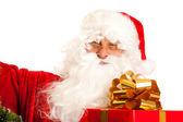 Santa Claus with present — Stock Photo