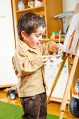 Preschool boy painting — Stock Photo