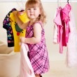 Sweet girl trying on clothes — Stockfoto #8662379