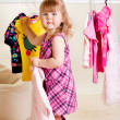 Sweet girl trying on clothes — Stockfoto