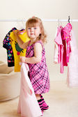 Sweet girl trying on clothes — Stock Photo
