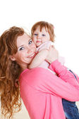 Mother holding daughter — Stock Photo