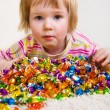 Girl and candies — Stock Photo