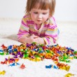 Little girl looking at candies — Stock Photo