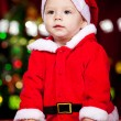 Baby boy in Santa hat - Stock Photo