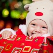 Baby in deer hat - Stock Photo
