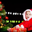 Baby in Santa costume over black - Stok fotoğraf