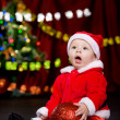 Surprised toddler with Christmas ball - Stok fotoğraf
