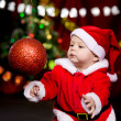 Santa helper playing with Christmas ball - Foto de Stock