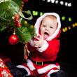 Giggling Santa baby - Stock Photo