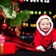 Cheerful Santa helper crawling - Stok fotoğraf
