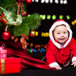 Cheerful Santa helper crawling - Stock Photo