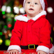 Infant in Santa costume - Stok fotoğraf