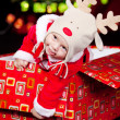 Baby in a present box - Stock Photo