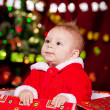 Toddler in Christmas costume - Stock Photo