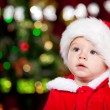 Toddler in Santa hat - Stock Photo