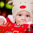 Baby in a red present box - Stok fotoğraf