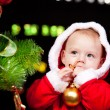 Baby  beside Christmas tree - Stock Photo