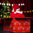 Santa helper in present box — Stock Photo