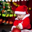Baby playing with Christmas ball — Stock Photo