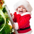 Toddler decorating Christmas tree - Stok fotoğraf