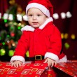 Little boy in Santa clothing - Foto Stock